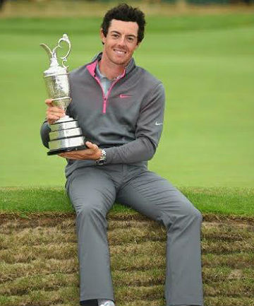 DREAM COME TRUE: Rory McIlroy poses with the Claret Jug after winning the British Open at the weekend.