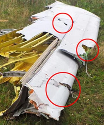 'PROOF': Shrapnel damage suggests an SA-11 proximity frag warhead may have exploded slightly below and ahead of #MH17's port wing, Royal United Services Institute analyst Justin Bronk said.