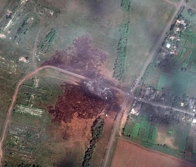 A satellite image shows the crash site of Malaysia Airlines flight MH17 in Ukraine, dangerously close to a village.