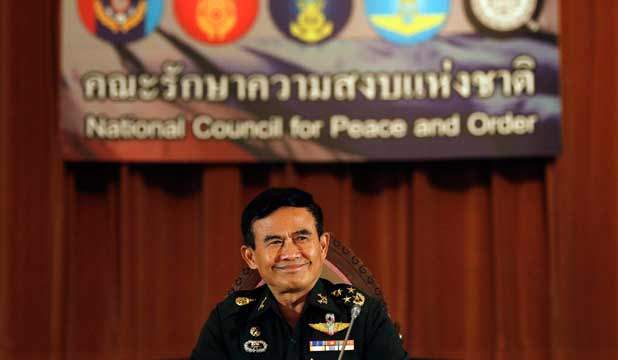 Thailand's Deputy National Council for Peace and Order chief General Paiboon Koomchaya smiles during Wednesday's news conference.