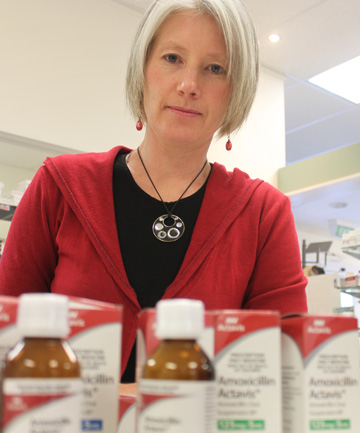 Cromwell Pharmacy owner and pharmacist Jackie Hamilton with bottles of Actavis Amoxicillin oral liquid collected from patients following the recall of the medicine last week.