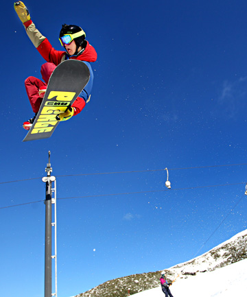 Hang time: Jack Parsons takes to the air while snowboarding on Mt Taranaki yesterday.?bbPhoto: CHARLOTTE CURD/ FAIRFAX NZ