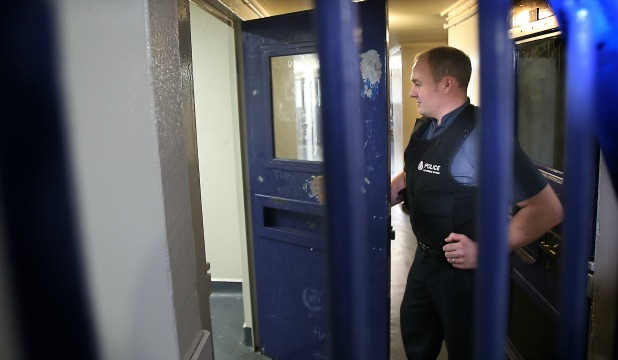 Authorised officer Adrian Balman outside one of the Timaru police cells