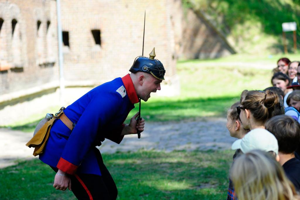 "A tourist guide dressed as a first civil war soldier shouts at children, during a tour of the old military fortress known as ""Fort Gerhard"", in Swinoujscie, Poland."