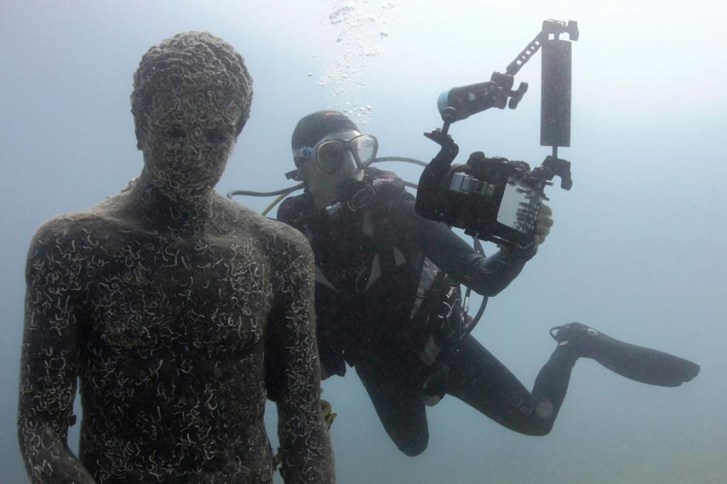 "A diver takes a ""selfie"" with a replica of Apoxyomenos from the first or second century BC in Historical Underwater Park in Mali Losinj . The park features 11 different exponents, placed between 5 and 15 metres deep in the water, which testify the rich history of Losinj island and its region."