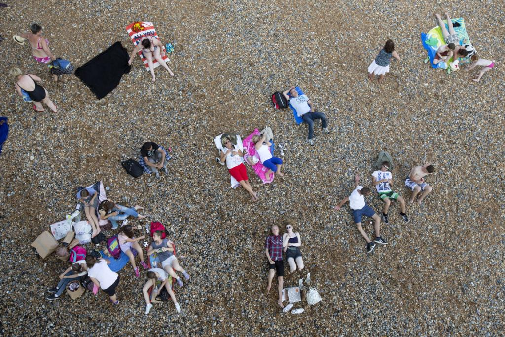 Members of the public relax in the warm weather on Brighton beach in Brighton, England.