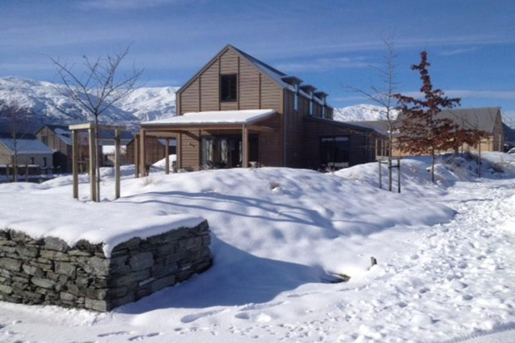 ARROWTOWN, OTAGO: This two-level timber home has been designed with snow sports in mind, but it is also right in the middle of a 27 hole golf course for the summer months.