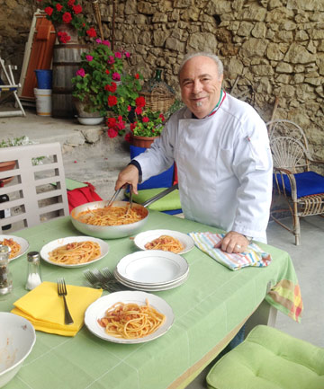 NO FRILLS: Chef Ezio Gentile plates pasta for lunch at the cooking school in Vittorito, Italy, where he teaches.