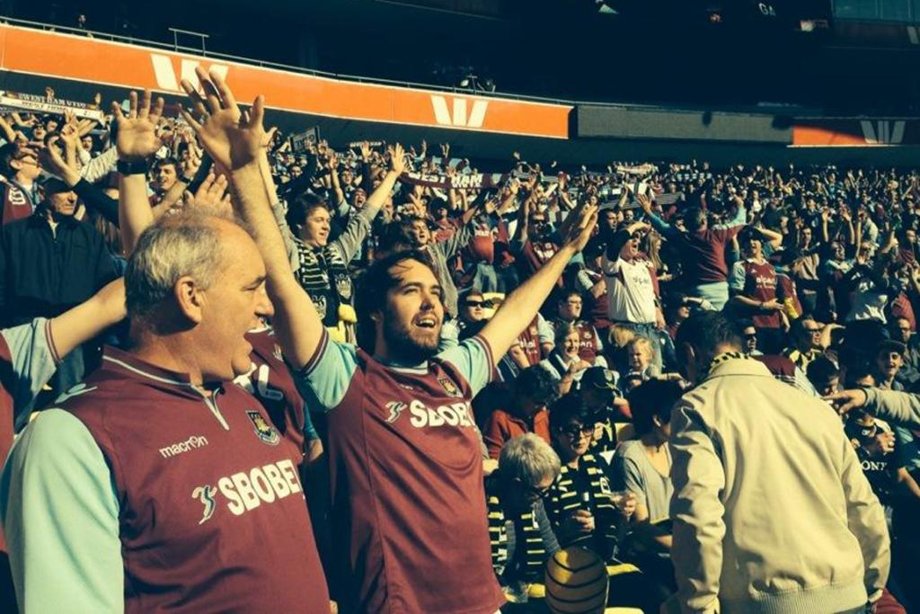 BUBBLY: West Ham fans stand to sing Forever Blowing Bubbles.
