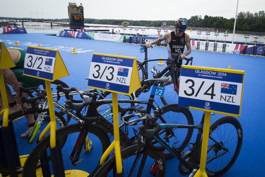 Ryan Sissons makes a costly error, over-shooting the New Zealand bike rack during the final leg over the mixed team triathlon.