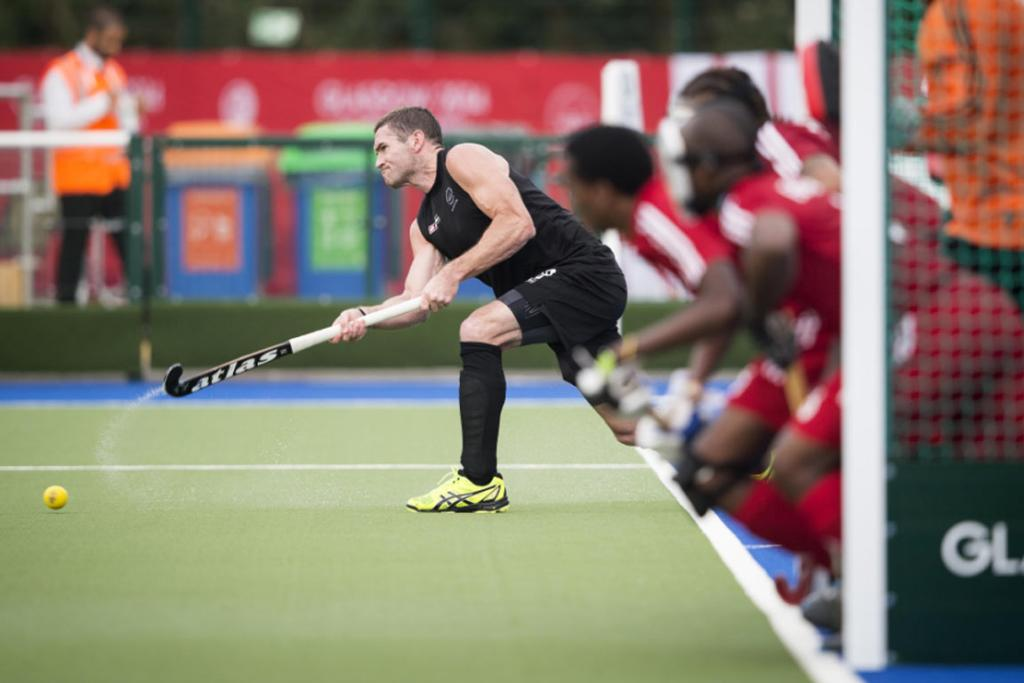 Phil Burrows takes a penalty corner during the Black Sticks rout of Trinidad and Tobago.