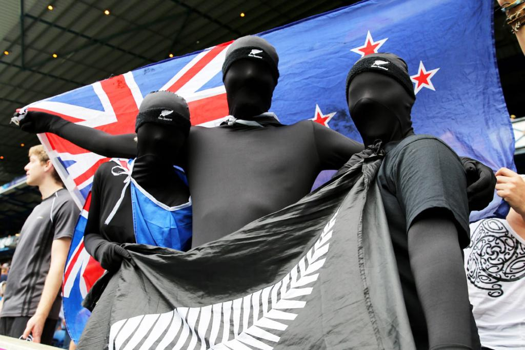 Black lycra suit-clad New Zealand sevens fans at Ibrox Stadium.