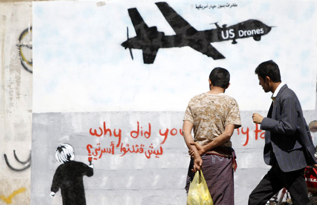 DESERT STORM: Graffiti on a wall in Yemen protests drone strikes.