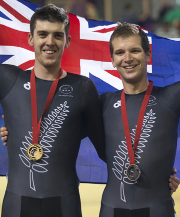THAT'S GOLD: Tom Scully, left, and Aaron Gate celebrate gold and bronze in the final of the 40km points race in Glasgow.