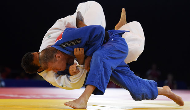 OUCH: Tim Slyfield on his way to beating India's Sahil Pathanian, a man 12 years his junior by ippon.