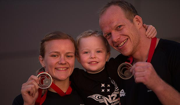 FAMILY PRIDE: Christchurch couple Moira de Villiers, left, and Jason Koster both won judo medals. They are with Koster's young son, Sam.