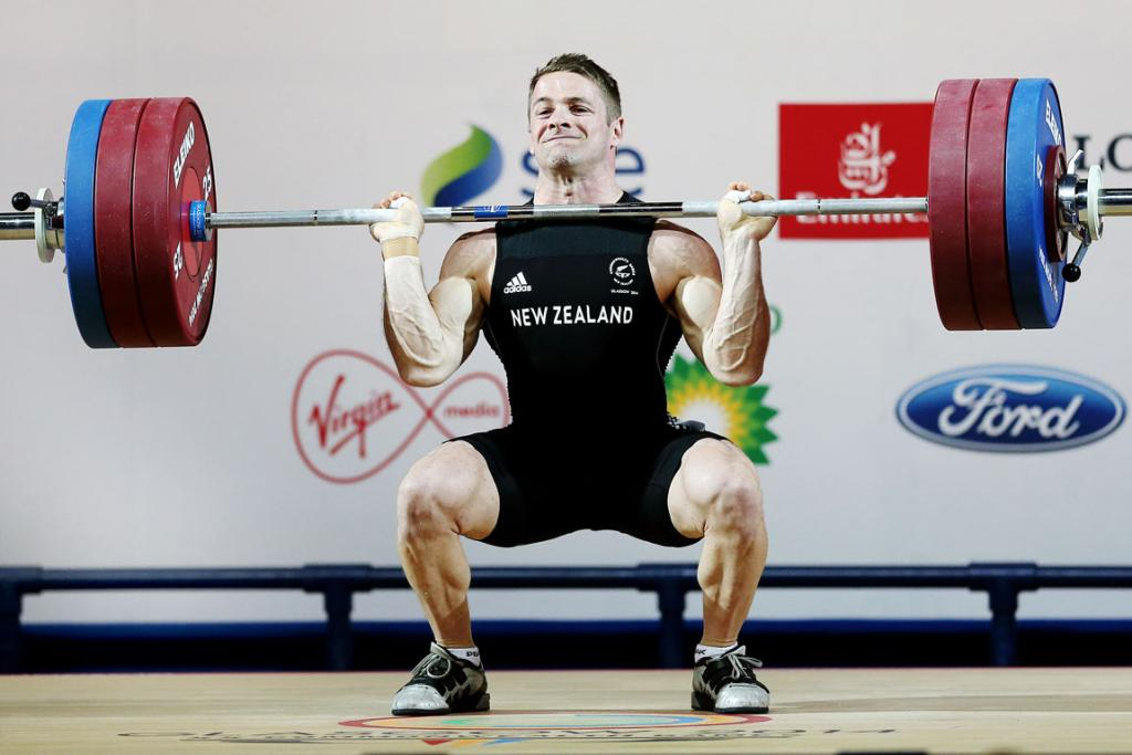 Kiwi Mark Spooner cleans during competition in the men's 69kg Group A final.