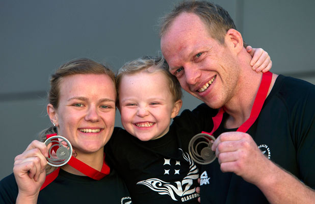 ONE FOR THE ALBUM: Christchurch couple Moira de Villiers, left, and Jason Koster both won judo medals. They are pictured with Jason Koster's son, Sam.