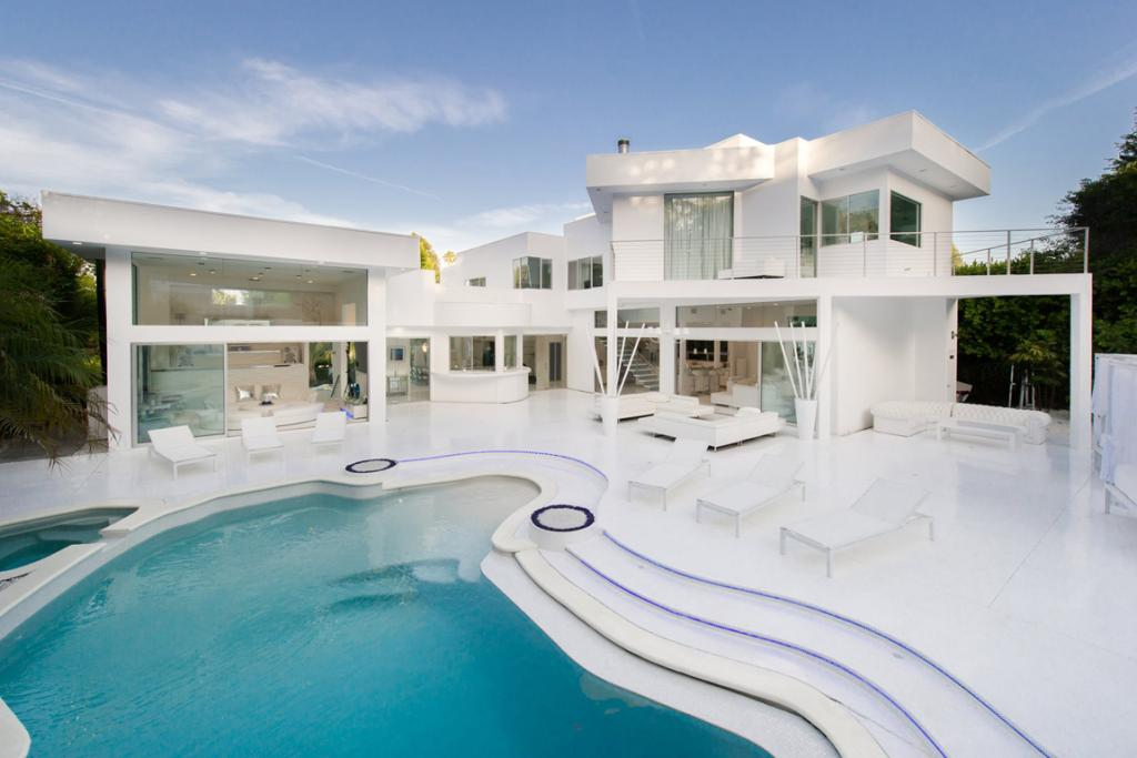 LIKE A MUSIC VIDEO: The focal point of this all-white home is its ginormous pool.