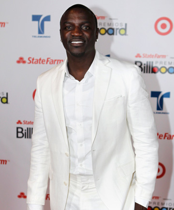 AKON: He wants to sell up right now, na na. (He also clearly dresses to match his decor).
