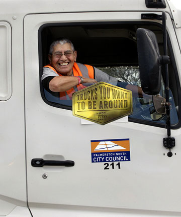 Good as gold: Palmerston North City Council truck driver Amos Ratahi displays one of the first badges celebrating the fleet's safety rating.