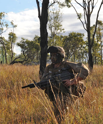 Mission accomplished: A New Zealand Army soldier prepares to take aim during Exercise Hamel, the Australian Army's annual foundation warfighting exercise, which was held in Townsville, northern Queensland.