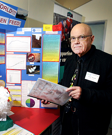 SOUND SCIENCE: Chief judge Rick Wood is impressed with the methods and techniques used by pupils Alton Gondipon and Patrick Fisher-Evans in their science investigation.