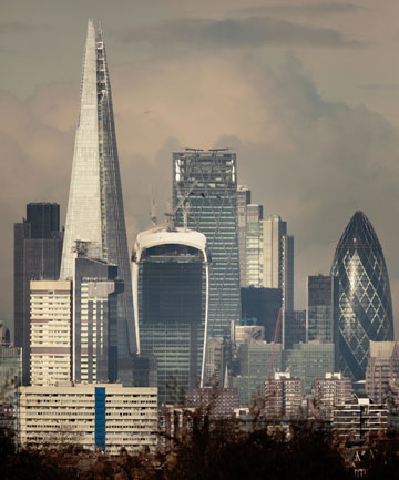 LONDON'S TALL TOWERS: The tallest tower is known as The Shard, the white topped building next to it the Walkie Talkie, and the curvy job to the far right is The Gherkin.