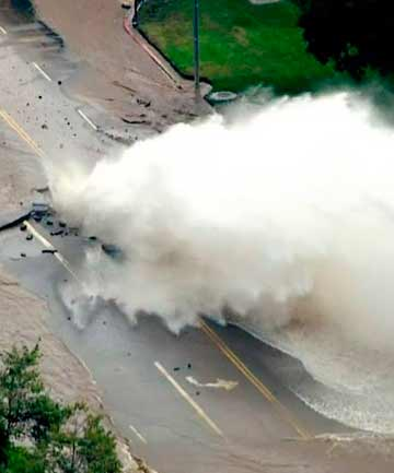 GEYSER: Water gushes from a broken water main on Sunset Boulevard on the UCLA campus in Los Angeles.