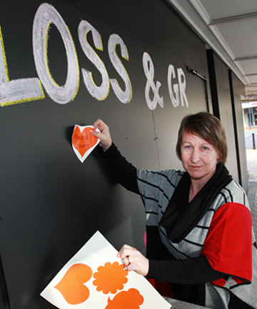 A PLACE TO SHARE: Invercargill woman Caroline Loo prepares a remembrance wall for Loss and Grief Awareness Week.