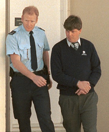 FLASHBACK: Constable Steve Wills with Robin Churchill after Churchill was charged with the murder of his wife, Sharon, in 1993.