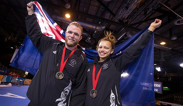 KIWI PRIDE: NZ wrestlers Sam Belkin, left, and Tayla Ford celebrate with their Commonwealth Games bronze medals in Glasgow.