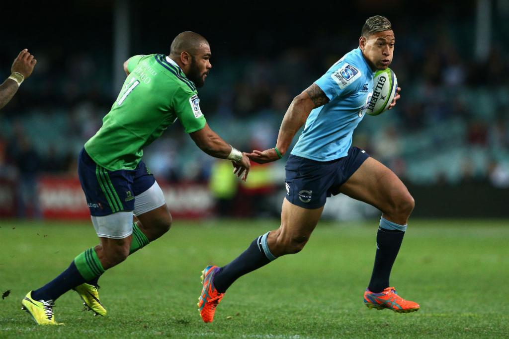 HARD TO STOP: The Crusaders will keeping a close watch on Waratahs dangerman Israel Folau, pictured fending off the Highlanders' Canterbury wing Patrick Osborne.