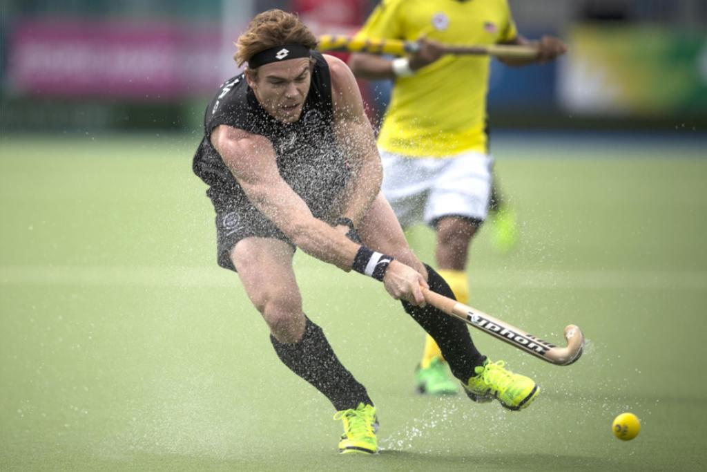 Andy Hayward kicks up water from the turf as he takes a shot during the Black Sticks' 6-1 victory over Malaysia.