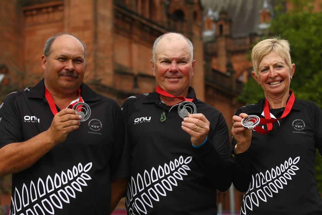 The New Zealand para-bowls triple of (from left) Mark Noble, Barry Wynks and Lynda Bennett show off their silver medals.