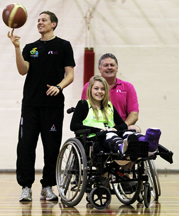 BASKETBALL DREAMS: Hanna Moore, 14, in her team uniform with Rob Haveswood, of Sport Taranaki, and Terry Long, of the Mellowpuff Charitable Trust.
