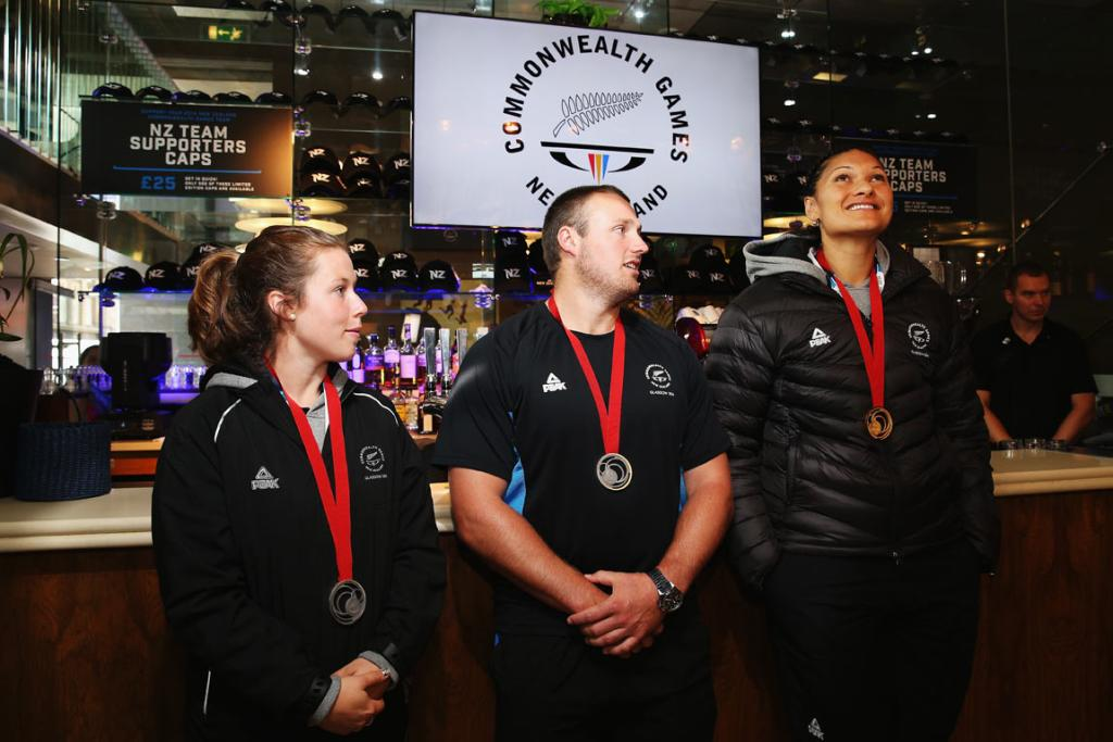 New Zealand athletics medalists (from left) Julia Ratcliffe (silver), Tom Walsh (silver) and Val Adams (gold) at a reception in Glasgow.