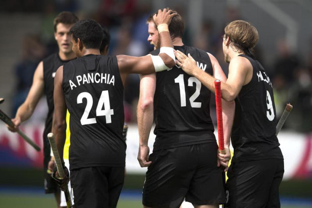Brad Shaw is congratulated by Arun Panchia and Blair Hilton after scoring New Zealand's second goal against Malaysia.