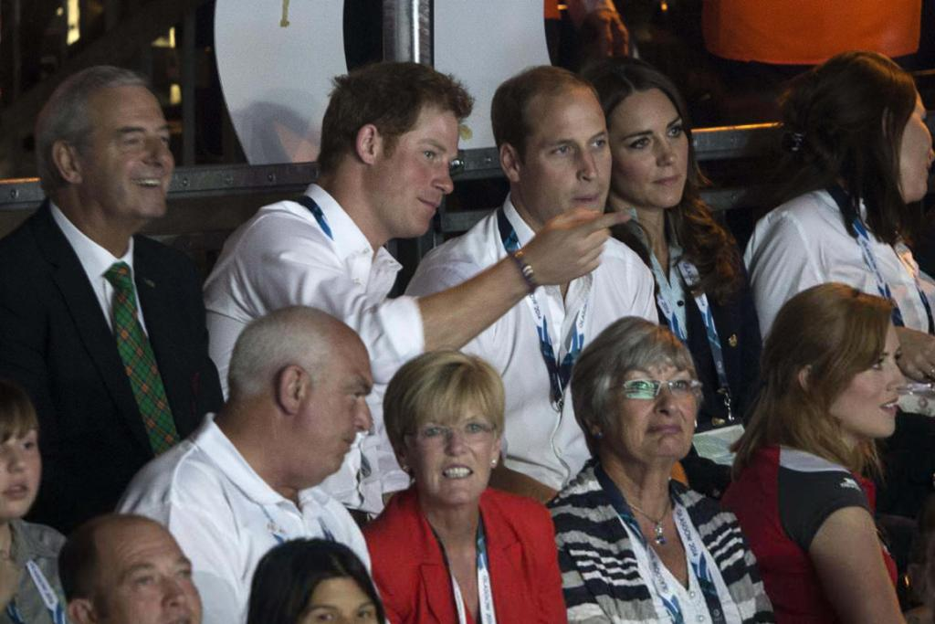 Prince Harry, Prince William and Kate Middleton watch the individual apparatus gymnastics finals.