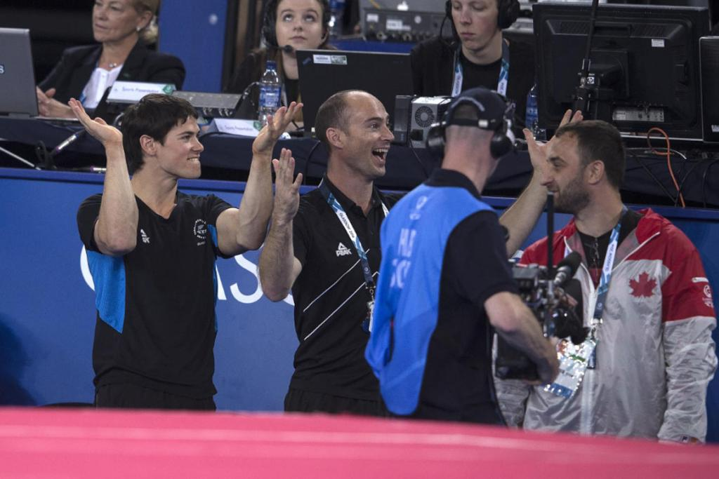 David Bishop (left) and coach David Phillips react as they realise a bronze medal has been clinched, New Zealand's first gymnastics medal since Phillips in 1998.