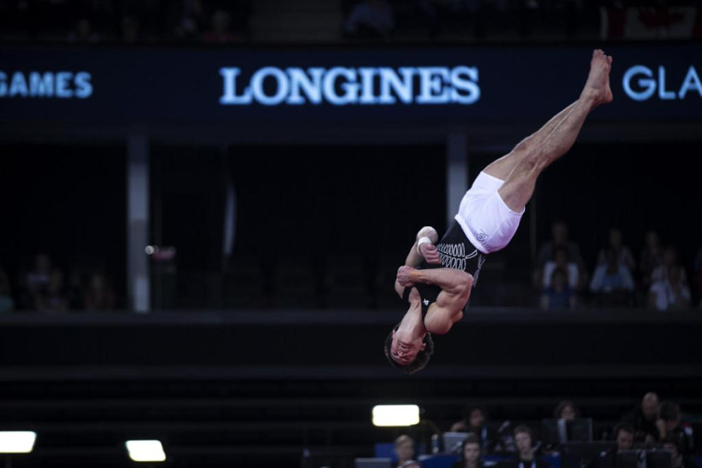 David Bishop tumbles during his men's floor final routine, which earned him a surprise bronze medal.