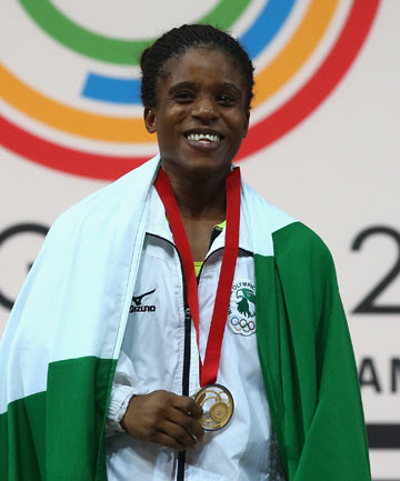 NO BLING: Nigerian Chika Amalaha will have to return the gold medal she received in the women's 53kg weightlifting competition after a positive drugs test.
