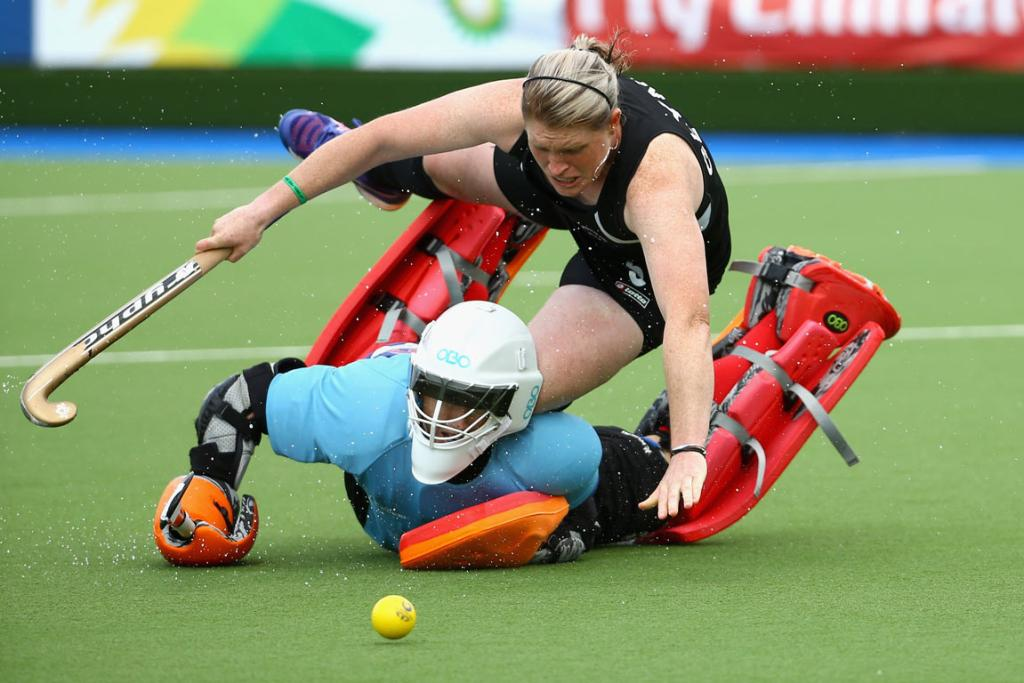 Katie Glynn is dispossessed and taken out by England goalkeeper Maddie Hinch during the shootout.