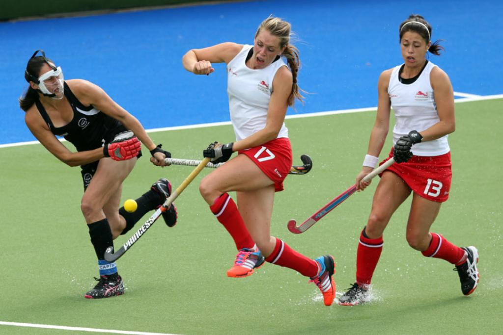 Kayla Whitelock attempts to clear the ball from New Zealand's end after a penalty corner.
