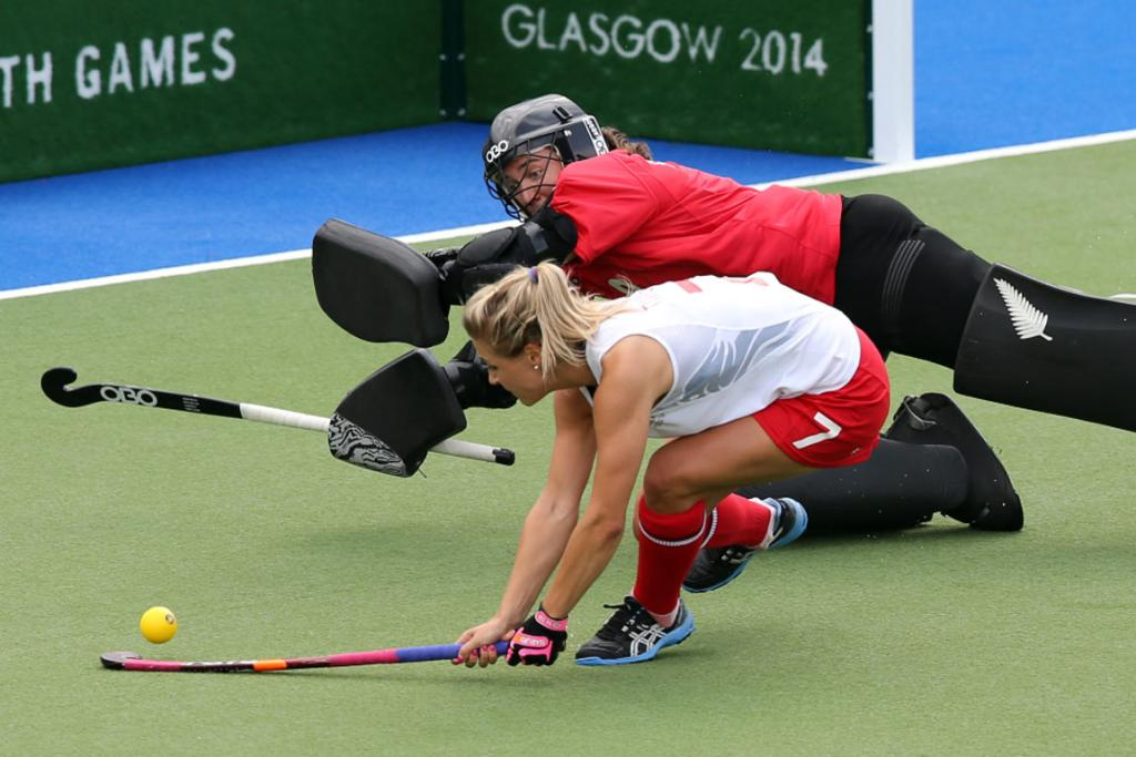 NZ goalkeeper Sally Rutherford cannot stop the shootout attempt from England's Georgie Twigg.