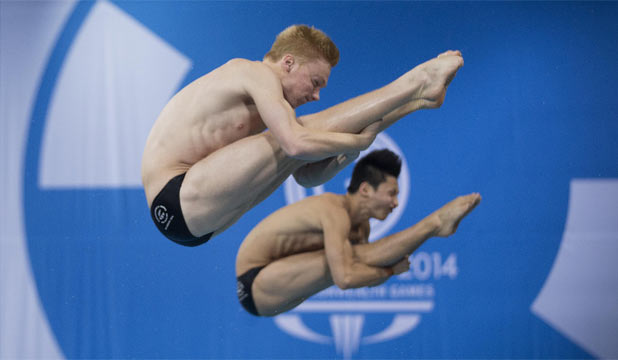 TOUGH GOING: Kiwis Liam Stone and Li Feng Yang compete in the men's synchronised diving 3m springboard final in Edinburgh.