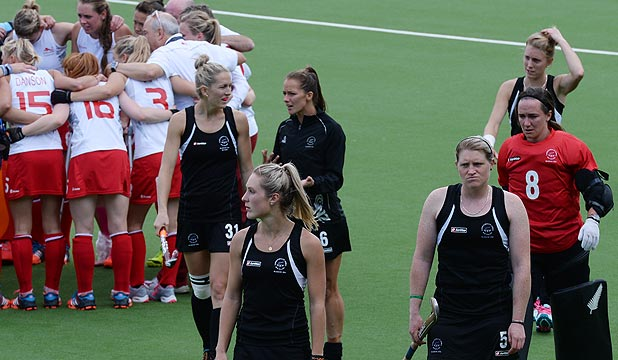 GUTTED: Members of the NZ women's hockey team trudge off the turf following their shock loss to England in the Commonwealth Games semifinals.