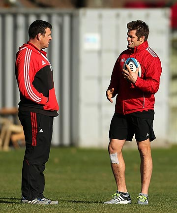 BRAINS TRUST: Dave Hewett (left) and Richie McCaw enjoy a light moment at Crusaders training.