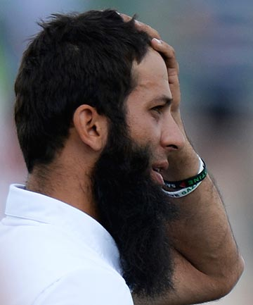 NOT ALLOWED: England cricketer Moeen Ali wears wristbands with