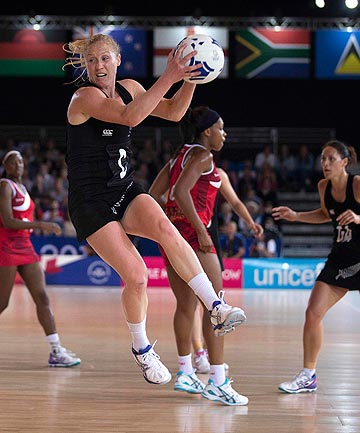 FLAT OUT: Silver Ferns centre Laura Langman flies through the air during the Commonwealth Games against England in Glasgow.
